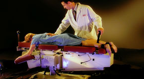This is a picture of Cox Technic chiropratic spinal manipulation as performed at Most Chiropractic Clinic.